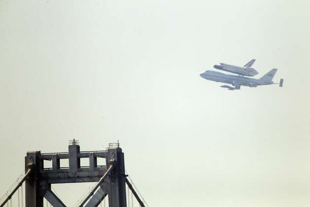 The Space Shuttle Endeavor flew over the Bay Area on Friday, September 21, 2012, in San Francisco, Calif., on its farewell voyage before it is converted to a museum in Los Angeles. Photo: Carlos Avila Gonzalez, The Chronicle