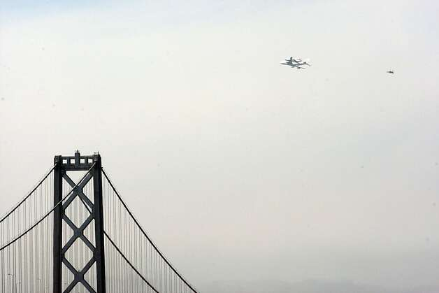 The Space Shuttle Endeavour with the Bay Bridge in the foreground as it flew over the Bay Area on Friday, September 21, 2012, in San Francisco, Calif., on its farewell voyage before it is converted to a museum in Los Angeles. Photo: Carlos Avila Gonzalez, The Chronicle