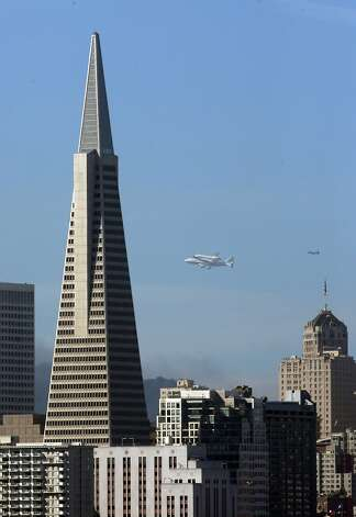 The Space Shuttle Endeavour with the Transamerica Pyramid in the foreground as it flew over the Bay Area on Friday, September 21, 2012, in San Francisco, Calif., on its farewell voyage before it is converted to a museum in Los Angeles. Photo: Carlos Avila Gonzalez, The Chronicle