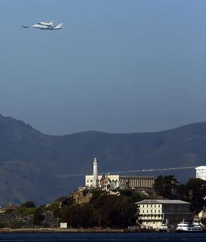 The Space Shuttle Endeavour with Alcatraz in the foreground as it flew over the Bay Area on Friday, September 21, 2012, in San Francisco, Calif., on its farewell voyage before it is converted to a museum in Los Angeles. Photo: Carlos Avila Gonzalez, The Chronicle