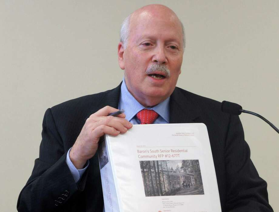 First Selectman Gordon Joseloff discusses plan to develop a 100-unit residential complex for seniors on the town-owned Baron's South property during a Friday meeting of the Baron's South Committee. Photo: Paul Schott / Westport News