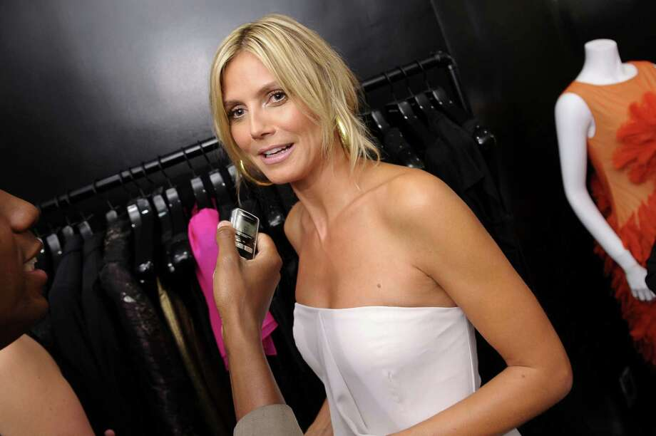 Heidi Klum  aims to take legal action at photographers who caught her topless on vacation. 