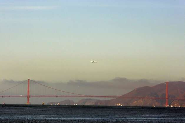 The Space Shuttle Endeavour flew over the Bay Area on Friday, September 21, 2012, in San Francisco, Calif., on its farewell voyage before it is converted to a museum in Los Angeles. Photo: Carlos Gonzalez, The Chronicle