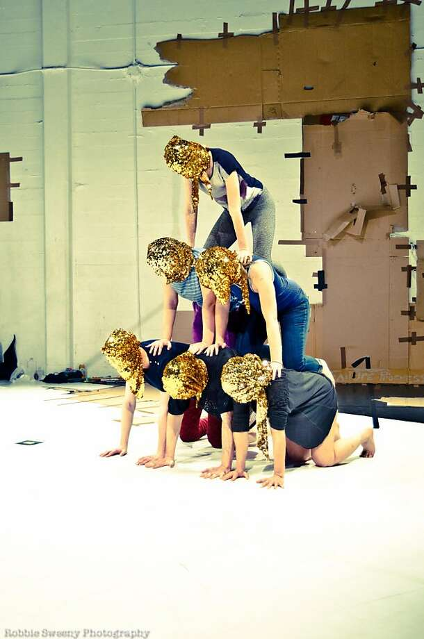 "Emily Leap (above left), Keith Hennessy and Jesse Hewit in Hennessy's ""Turbulence."" Left: Dancers, their heads swathed in gold fabric, build a pyramid. Most of the dance consists of improvised movements. Photo: Robbie Sweeney Photography"