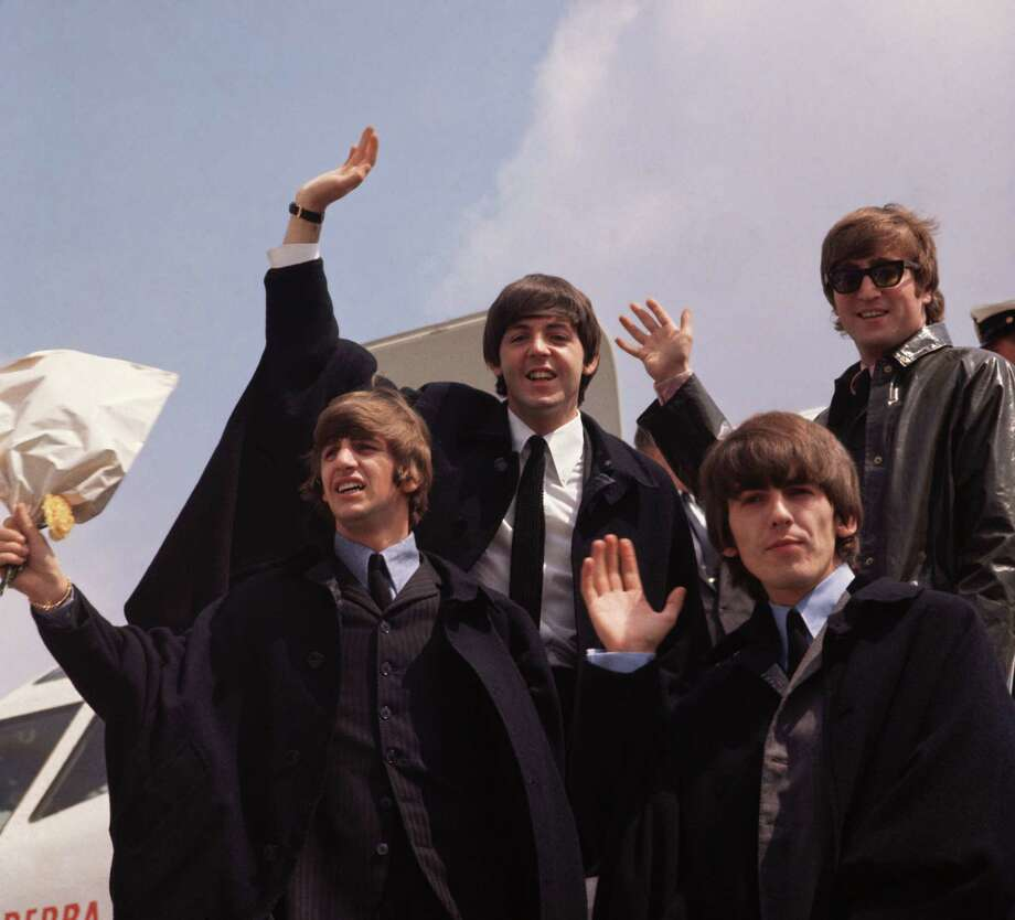 And their dads: The Beatles in 1964: John Lennon, George Harrison, Paul McCartney and Ringo Starr, pictured on their arrival in London following a tour of Australia. Photo: Fox Photos / Hulton Archive