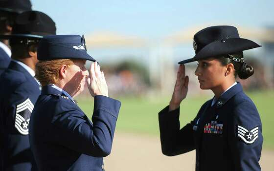 Sept. 21, 2012: Col. Deborah Liddick, left,  salutes new military training instructor Staff Sgt. Abigail Rodriguez, after taking command of the Air Force basic training program at JBSA-Lackland. Photo: Billy Calzada, San Antonio Express-News / © San Antonio Express-News