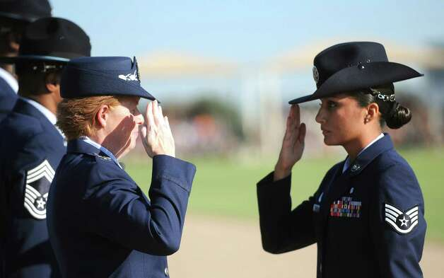 Sept. 21 2012: Col. Deborah Liddick, left,  salutes new military training instructor Staff Sgt. Abigail Rodriguez, after taking command of the Air Force basic training program at JBSA-Lackland. Photo: Billy Calzada, San Antonio Express-News / © San Antonio Express-News