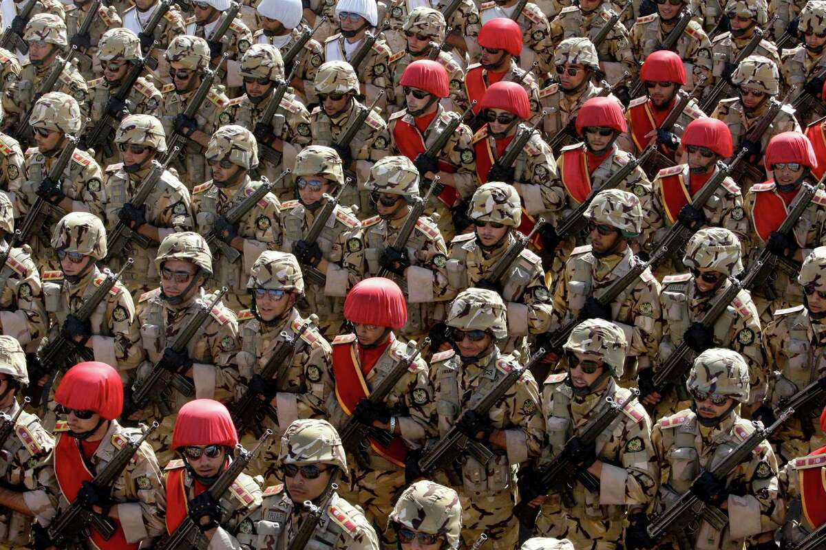 Iranian army troops march in a military parade commemorating the start of the Iraq-Iran war 32 years ago, in front of the mausoleum of the late revolutionary founder Ayatollah Khomeini, just outside Tehran, Iran, Friday, Sept. 21, 2012.
