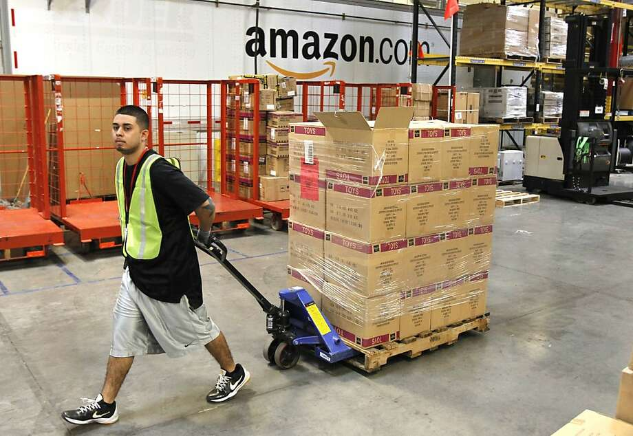 FILE - In this Nov. 11, 2010 file photo, Humberto Manzano, Jr., delivers an arriving pallet of goods at an Amazon.com fulfillment center in Phoenix.  Products are flying off the shelves at Amazon warehouses across the county as Californians prepare to start paying sales taxes on online purchases. The change, which takes effect Saturday, Sept. 15, 2012, will pave the way for the e-commerce giant to open warehouses in California and offer same-day shipping to customers.  (AP Photo/Ross D. Franklin, file) Photo: Ross D. Franklin, Associated Press