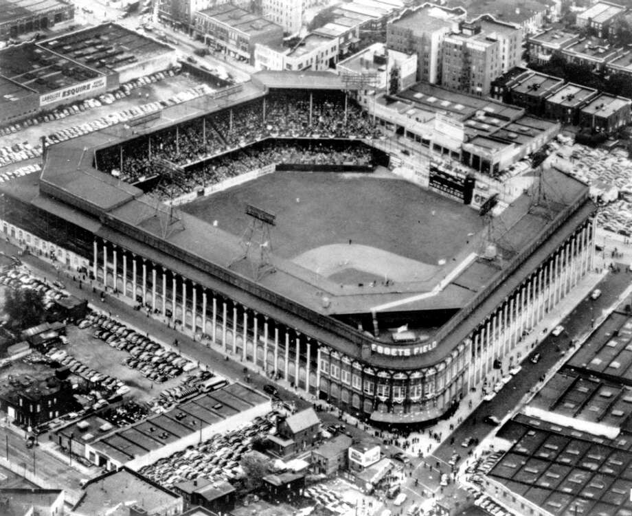 FILE - This file photo of Sept. 13, 1942 gives an aerial view of Ebbets Field, home to the Brooklyn Dodgers baseball team, in Brooklyn, New York. It was like a death in the family for Brooklyn baseball fans when their beloved Dodgers left the borough behind for the California coast. But after decades without a professional sports team, Brooklyn is hitting the major leagues again on Friday, Sept. 21, 2012 when the Brooklyn Nets' new arena opens to the public. Photo: TOM FITZSIMMON, AP / AP