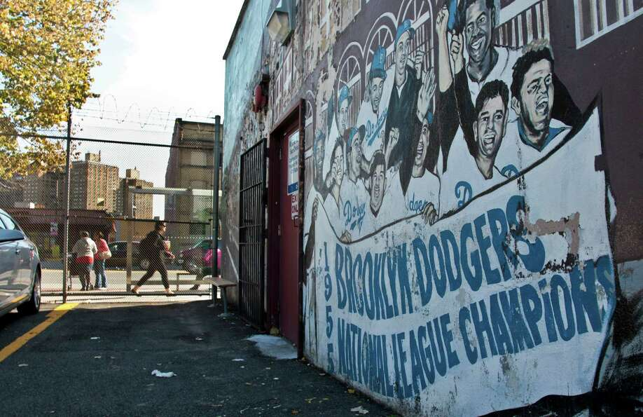 A mural recalling the Brooklyn Dodgers baseball team, shows signs of decay on the wall of a subway s