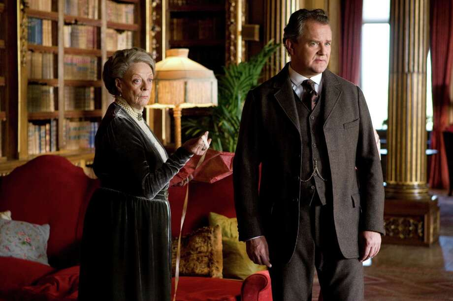 "In an undated handout photo, Maggie Smith, left, and Hugh Boneville in a scene from ""Downton Abbey,"" on PBS. During the Emmy Awards on Sept. 23, 2012, PBS and the show have the possibility of winning what is arguably the most sought-after award of the night: best drama. (Nick Briggs/Carnival Film and Television for Masterpiece, via PBS via The New York Times) -- NO SALES; FOR EDITORIAL USE ONLY WITH STORY SLUGGED TV EMMYS BY BRIAN STELTER. ALL OTHER USE PROHIBITED. -- Photo: NICK BRIGGS / CANIVAL FILM AND TELEVISION FOR MASTERPIECE VIA PBS"