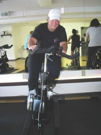 A spinning student at Saratoga Core Fitness in Saratoga, NY, demonstrates turning and leaning on the new Real Ryder spin bikes. (Carin Lane/Times Union)