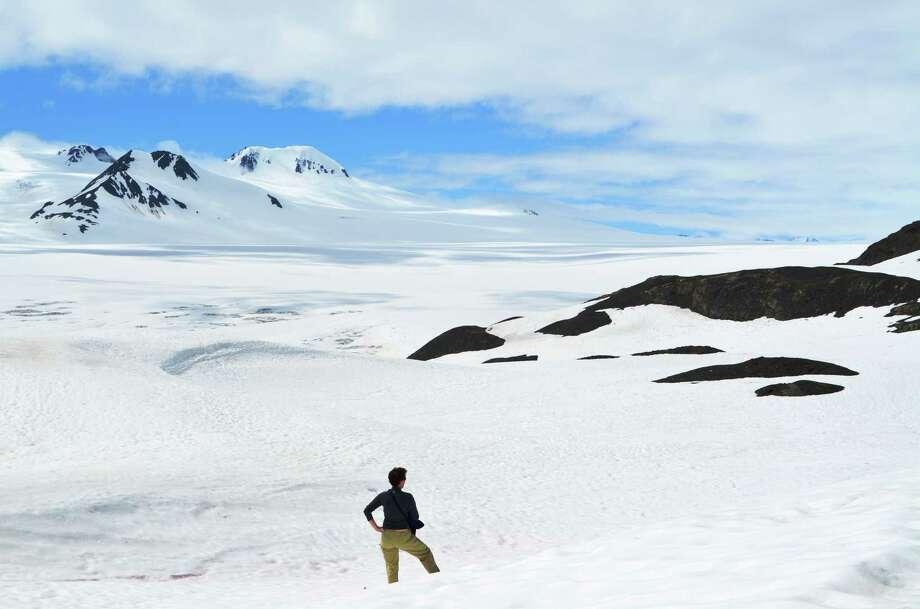 Roberta MacInnis pauses on the trail as she approaches the Harding Icefield, part of the Kenai Fjords National Park.  near Seward, Alaska. Photo: Jason MacInnis