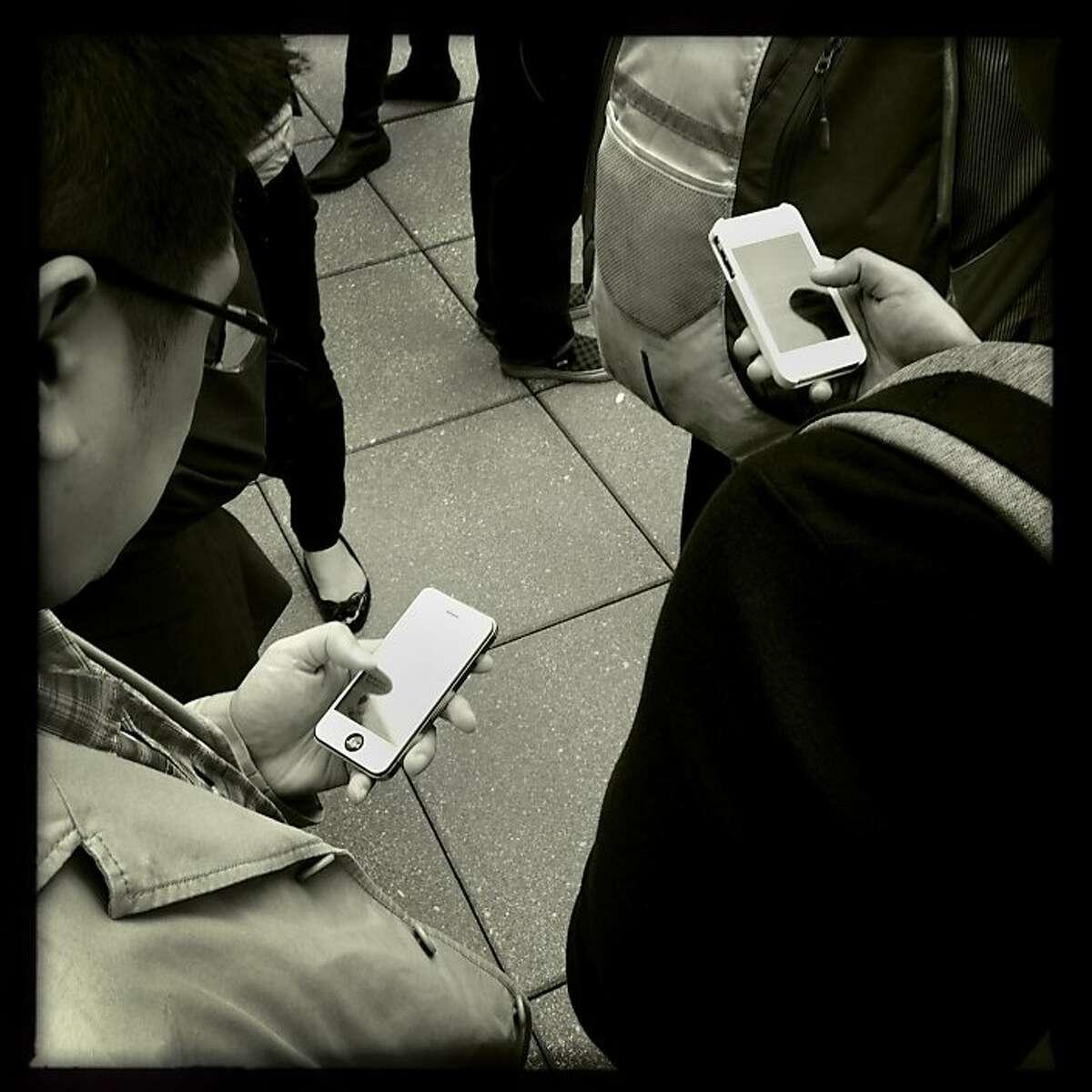 People use their smartphones.