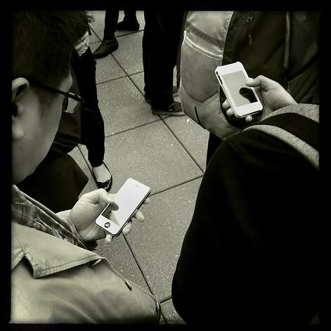 Smartphone world - untitled #4 Photo: Mike Kepka, The Chronicle