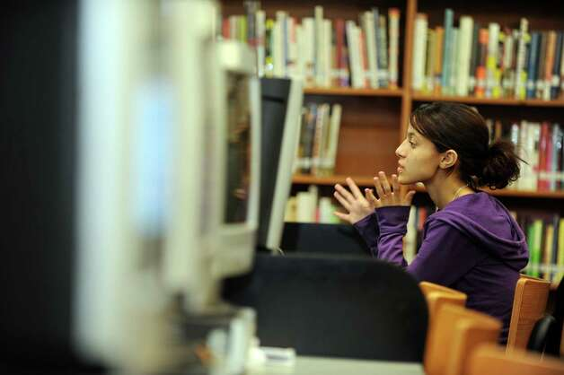 Central High School student Briana Pinero, 17, studies online Friday, Sept. 21, 2012 during the Twilight program, a new alternative education program that serves kids who don't do well in regular school and runs 3:30 to 7:30 p.m. at all three city high schools. Photo: Autumn Driscoll / Connecticut Post