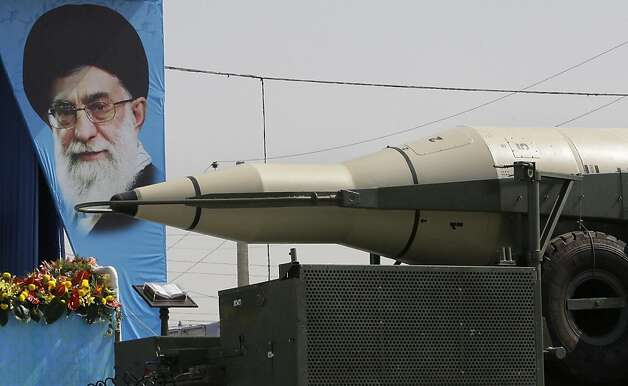 Troops display a portrait of Iran's supreme leader, Ayatollah Ali Khamenei, next to a missile. Photo: Vahid Salemi, Associated Press