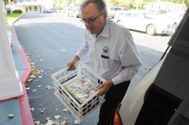Albany City Judge Tom Keefe unloads part of his political memorabilia collection on Friday, Sept. 21, 2012, as he prepared to display and trade his artifacts during a political memorabilia show held at the Best Western Sovereign Hotel in Albany, N.Y. The show is sponsored by the Monroe D Ray Chapter of the American Political Items Collectors, and is open to the public   Saturday. (Will Waldron / Times Union) Photo: Will Waldron