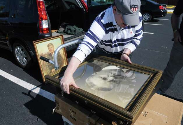 "Chris Hearn of Leesburg, Va., unloads a portrait of President Theodore ""Teddy"" Roosevelt, Friday, Sept. 21, 2012, as he prepared to display and trade artifacts during a political memorabilia show held at the Best Western Sovereign Hotel across from the University at Albany in Albany, N.Y.   (Will Waldron / Times Union) Photo: Will Waldron"