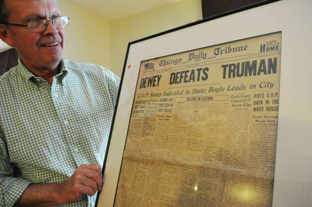 Bren Price, a collector from Buffalo, N.Y., holds a copy of the famed 1948 Chicago Daily Tribune presidential election page, Friday, Sept. 21, 2012, which incorrectly showed Thomas E. Dewey as the winner. Price is in Albany, N.Y. for a political memorabilia show held at the Best Western Sovereign Hotel across from the University at Albany. (Will Waldron / Times Union) Photo: Will Waldron