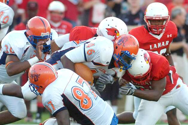 Lamar linebacker James Washington, right, collides with Langston University running back Ricky Shearin (24) for the stop during the first half at Provost Umphrey Stadium. Saturday, October 9, 2010 Valentino Mauricio/The Enterprise Photo: Valentino Mauricio / Beaumont