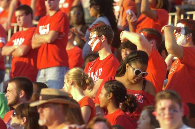 A Lamar fan, center,  not just another face in the crowd, shows his Cardinals pride during the first half against Langston University on Saturday, October 9, 2010. Valentino Mauricio/The Enterprise Photo: Valentino Mauricio / Beaumont