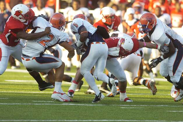 Langston University running back Carlos Ross (5) runs into a wall of Cardinals during the first half at Provost Umphrey Stadium.  Valentino Mauricio/The Enterprise Photo: Valentino Mauricio / Beaumont