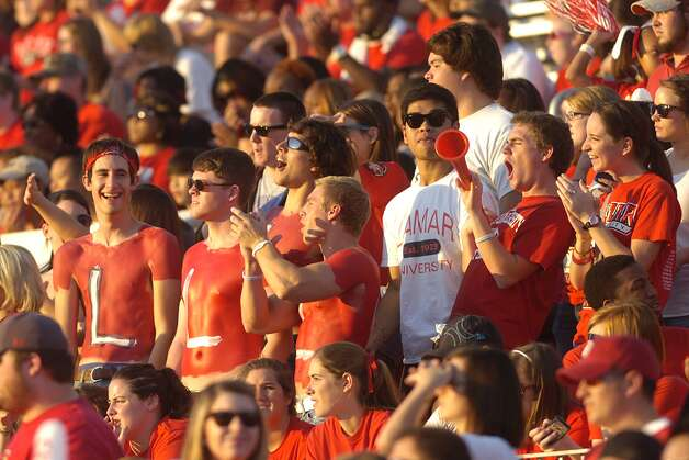 Lamar fans cheer the Cardinals on in the first half against Langston University during their homecoming matchup on Saturday, October 9, 2010. Valentino Mauricio/The Enterprise Photo: Valentino Mauricio / Beaumont