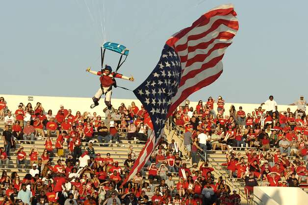 A member of Ground Rush Sky Diving prepares to land at Provost Umphrey Stadium with the flag of the United States during a pre-game show before the Cardinals homecoming matchup against Langston University Saturday, October 9, 2010 Valentino Mauricio/The Enterprise Photo: Valentino Mauricio / Beaumont