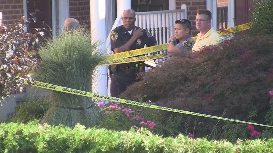 New Canaan Police said the man involved in what appears to be a murder-suicide was killed by a self-inflicted gunshot. Officers are not saying how the woman died.  Police responded to a report of shots fired at a condo complex on Park Street near Maple Street at about 2:40 p.m. Friday, and are still on scene. Photo: Steve Krauchick / Connecticut Post contributed