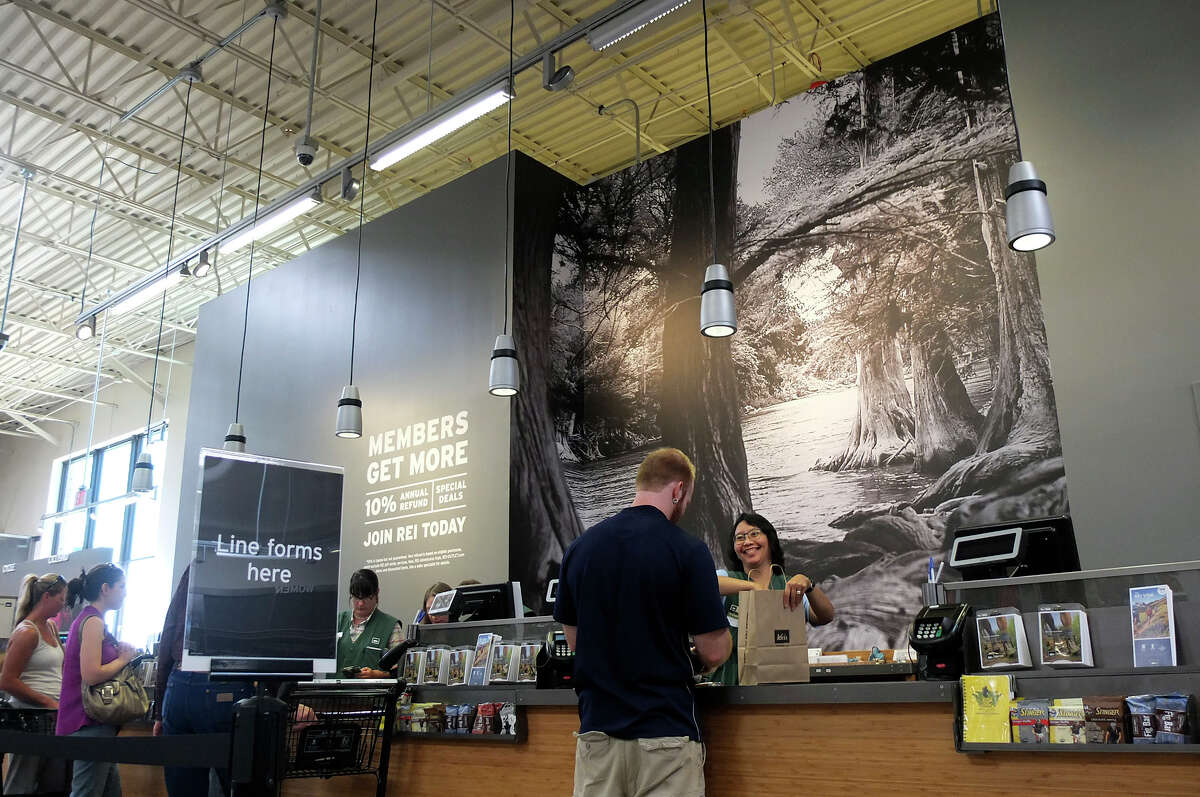 A mural of the Guadalupe river is seen on the wall by the checkout stations at REI San Antonio during the store's soft opening on Friday, Sept. 21, 2012. Over 28,000 square feet of space is devoted to outdoor recreational gear with about 70 employees on hand to serve its customers.The outdoor recreational goods retailer with over 100 stores throughout the country will have its San Antonio grand opening starting Oct. 5.