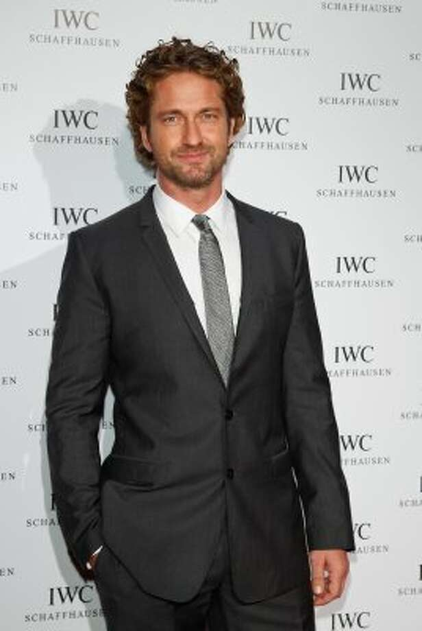 """Gerard Butler sculpted some serious abs — and pecs and lats and ... — for the movie """"300"""" by doing grueling workouts for up to six hours a day.  (Andreas Rentz / 2012 Getty Images)"""