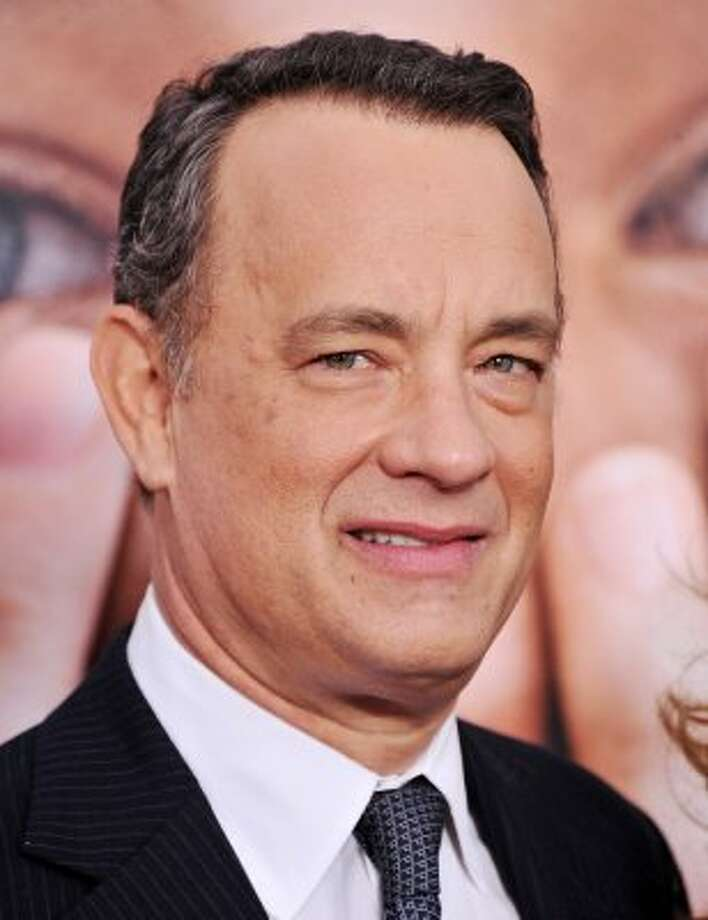 "For Tom Hanks' Oscar-nominated role in ""Cast Away,"" the actor took time off after filming the first half of the film so he could lose 45 pounds and grow his hair out.  (Stephen Lovekin / Getty Images)"