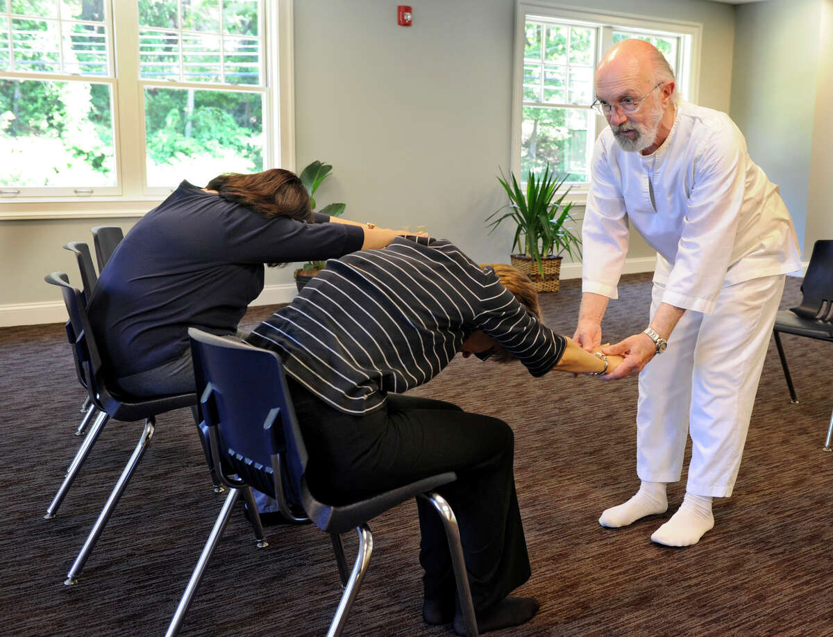Joe Gillotti of Danbury teaches chair yoga at Ann's Place in Danbury Friday, Sept. 21, 2012. This is one of 20 programs Ann's Place offers to people living with cancer to aid in their rehabilitation and recovery.