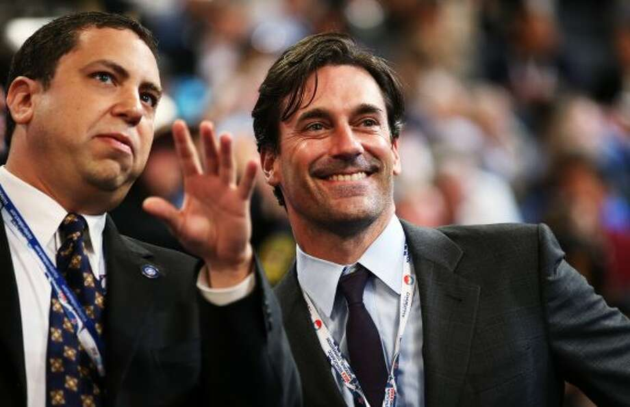 Jon Hamm (R) is now so famous that he doesn't need his once better known  girlfriend with him to gar