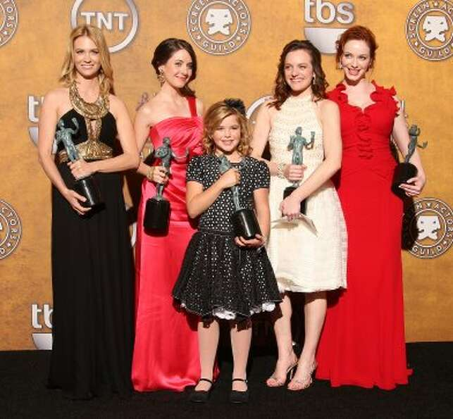 """Mad Men"" cast in 2009, with Screen Actor Guild awards. From L-R: January Jones, Alison Br"