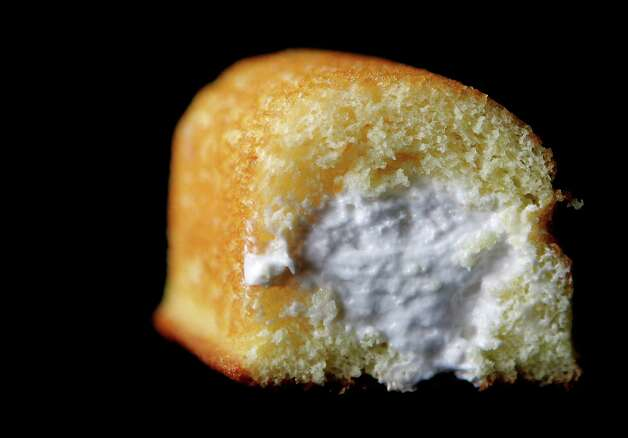 "Do Twinkies really last for years? Steve Ettlinger, author of ""Twinkie, Deconstructed,"" says the dairy-free, chemical-laden cakes don't spoil (but do get very hard). A science teacher told the Associated Press in 2004 that a 30-year-old Twinkie over his chalkboard had faded and dried out, but was ""probably still edible."" Hostess officials say Twinkies have a shelf life of 25 days (not years). Photo: Tim Boyle, Getty Images / 2005 Getty Images"
