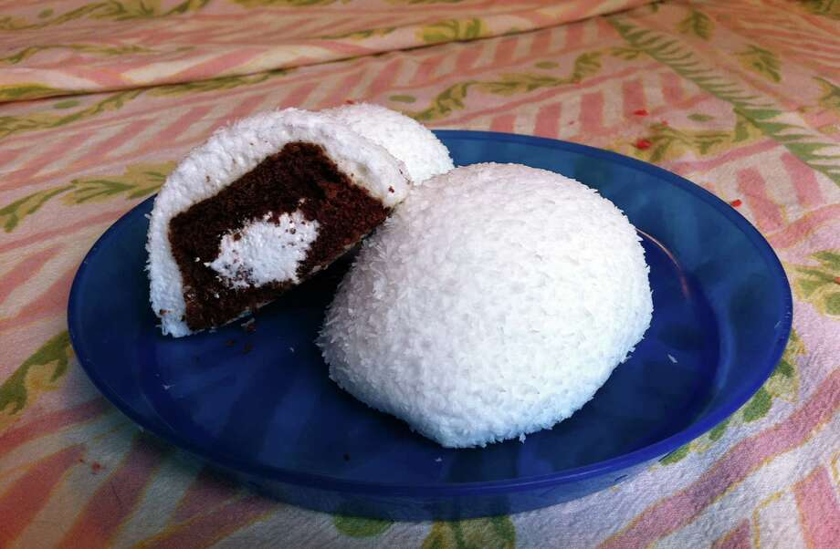 Sno Balls debuted in 1947, at a time when Americans were ready to splurge on sugar and fat. The rubbery marshmallow domes – which cover an upside-down Hostess CupCake – came at the end of wartime rationing of sugar and flour. Photo: Vanessa Ho/Seattlepi.com