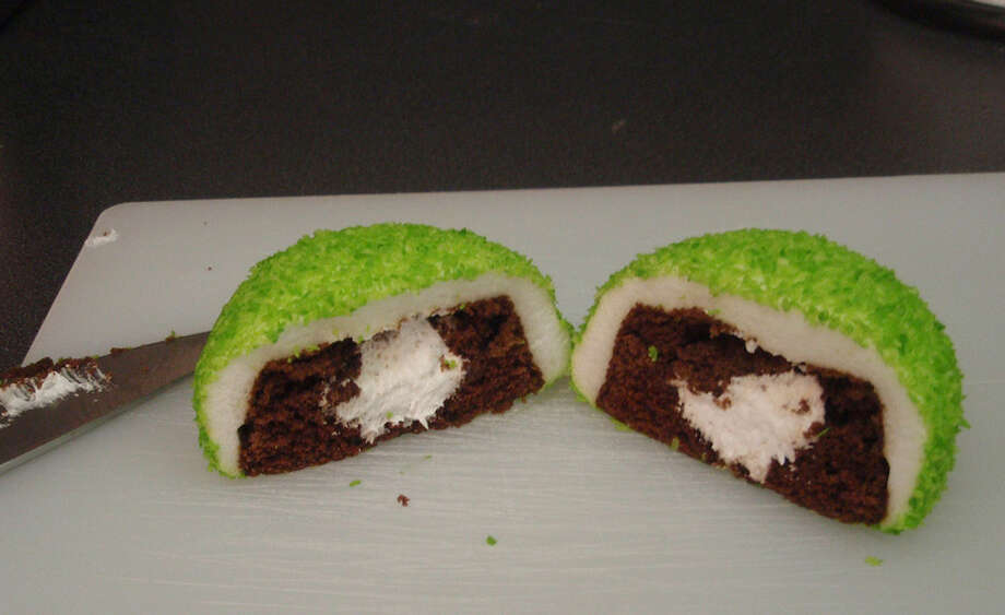 "If a cupcake injected with filling, coated in marshmallow goo and dusted in coconut isn't enough for you, Hostess also makes Sno Balls in different colors. Pink is popular.  But there's also neon green ""Glo Balls"" and less-artificial green ""Lucky Puffs."" Photo: JoelK75, Creative Commons Flickr"