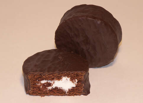 "Ding Dongs also came out in 1967. For many years, they were called ""King Dons"" or ""Big Wheels"" on the East Coast, to avoid confusion with ""Ring Dings,"" a similar chocolate-enrobed, hockey-puck-shaped thing that was around first. Photo: Wikimedia Commons"
