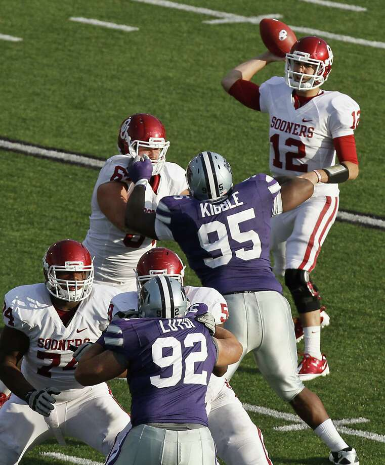 Quarterback Landry Jones #12 of the Oklahoma Sooners passes during a game against the Kansas State Wildcats in the third quarter at Bill Snyder Family Stadium on Oct. 29, 2011, in Manhattan, Kansas. Oklahoma won 58-17. Photo: Ed Zurga, Getty Images / 2011 Getty Images