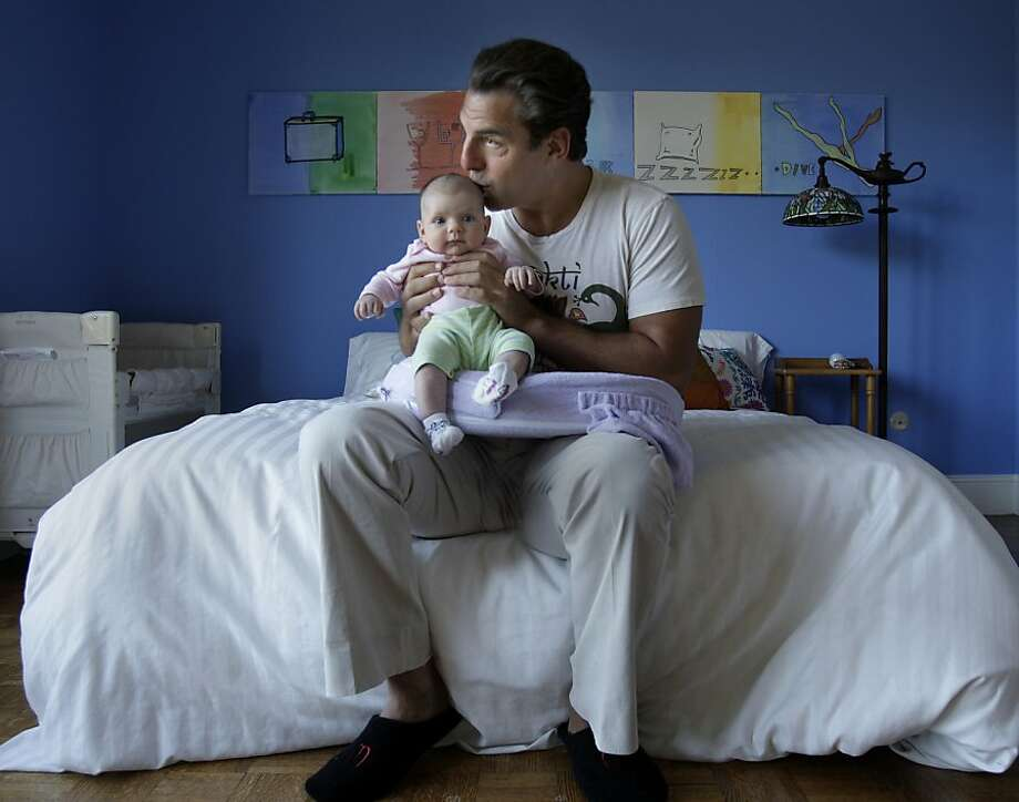 Andrew Zenoff kisses his daughter, Ruby, in their Marin County home. Photo: Brant Ward, The Chronicle