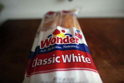 In the '40s, Wonder Bread was part of a government-sponsored program to enrich white bread with vitamins and minerals. The company now known as Hostess bought the maker of Wonder Bread in 1995. Photo: Spencer Platt, Getty Images / 2012 Getty Images