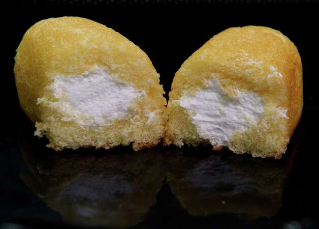 A photo of  Twinkies, made by Interstate Brands is viewed  on January 11, 2012 in  Washington,DC.   Hostess Brands, the baker of Twinkie cakes and other iconic American foods, filed for bankruptcy protection Wednesday after failing to win concessions on union contracts. Founded in 1930, Hostess owns brands that were emblematic of American food for generations. Its popular Twinkie, a snack cake with a creamy filling, was launched that year. The company claims its Wonder bread, a vitamin-enriched sliced bread, was the first 100 percent natural bread available across the United States. AFP Photo/Paul J. Richards Photo: PAUL J. RICHARDS, AFP/Getty Images / 2012 AFP
