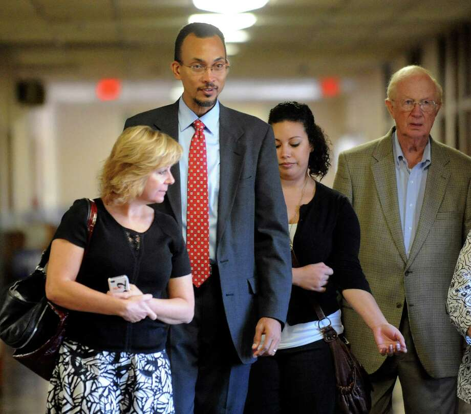 Anesthesiologist Dr. Brian Seastrunk, wearing tie, enters 37th District Court for a malpractice trial on Friday, Sept. 21, 2012. Attorneys for the parents of Maddoux Cordova, a 22-month-old boy who died after being given morphine upon Seastrunk's approval, argue that Seastrunk's decision led to the boy's death in 2009. Photo: Billy Calzada, San Antonio Express-News / © San Antonio Express-News