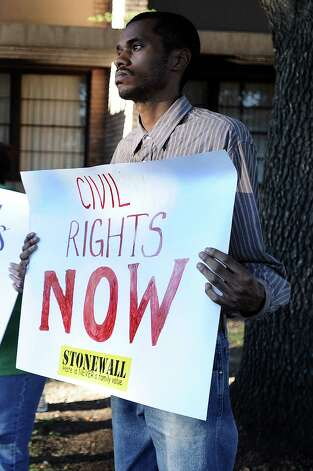 Protesters were posted outside the BISD board meeting on Thursday, September 20, 2012, in hopes to gain proof that an adult cosmetology class was canceled because of budget constraints and not because the principal at Taylor Career Center did not want to enroll a man he believes is gay. Photo taken: Randy Edwards/The Enterprise Photo: Guiseppe Barranco