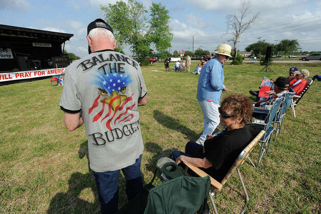 Jay Booth of Beaumont expresses himself with his t-shirt during the Southeast Texas Tea Party Patriot's tax day rally near Walden Road and Interstate 10 on Monday. Guiseppe Barranco/The Enterprise Photo: Guiseppe Barranco / Beaumont
