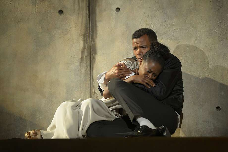 An impulsive Hamlet (LeRoy McClain) consoles the fragile Ophelia (Zainab Jah). Photo: Kevin Berne