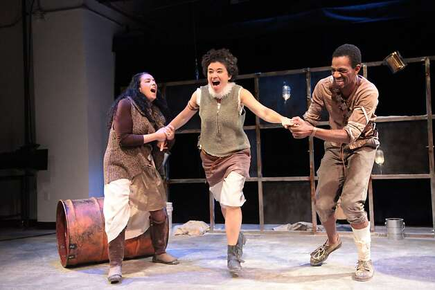 """Mother (Catherine Castellanos, left) and Father (Reggie D. White, right) try to restrain Scovia (Rami Margron) before the militia arrives in Erik Ehn's """"Dogsbody"""" at Intersection for the Arts Photo: Alexis Keenan"""